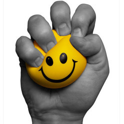Picture of hand squeezing yellow smiley face ball
