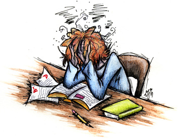 Picture of a person sitting at desk with head buried in hand at a desk filled with work.