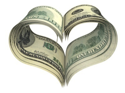Picture of stack of one hundred dollar bills in heart shape
